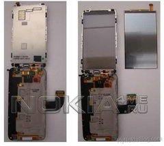 Nokia E7-00 бесцеремонно разобран на винтики